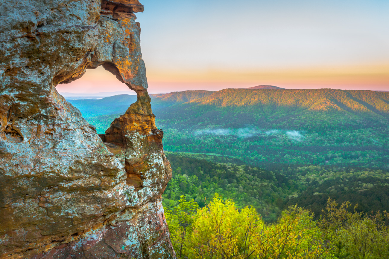 The first sunlights arrives at the rock outcrop known as Arkansas Sphinx in Johnson County.