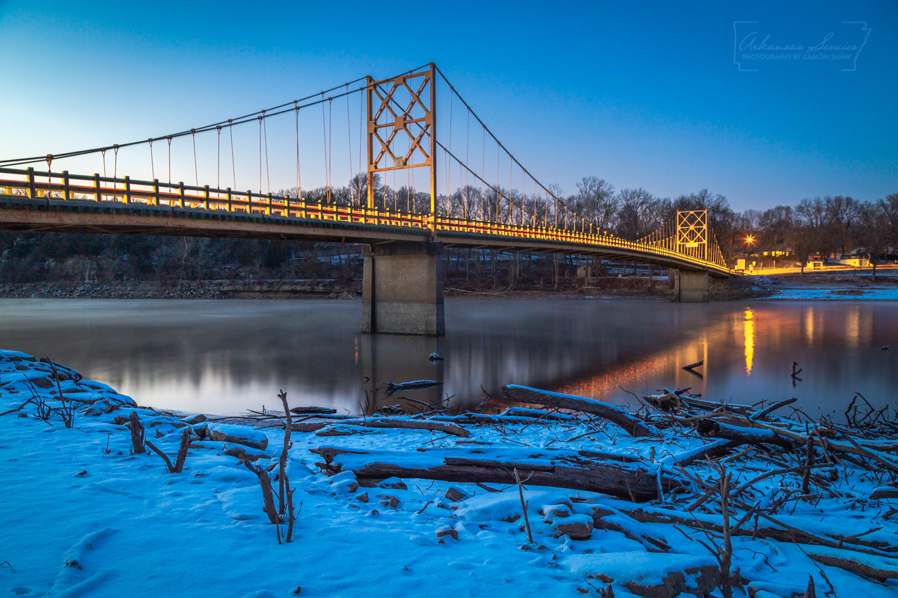 A car lights up the Beaver Bridge over the White River in Carroll County on a 4 degree evening.