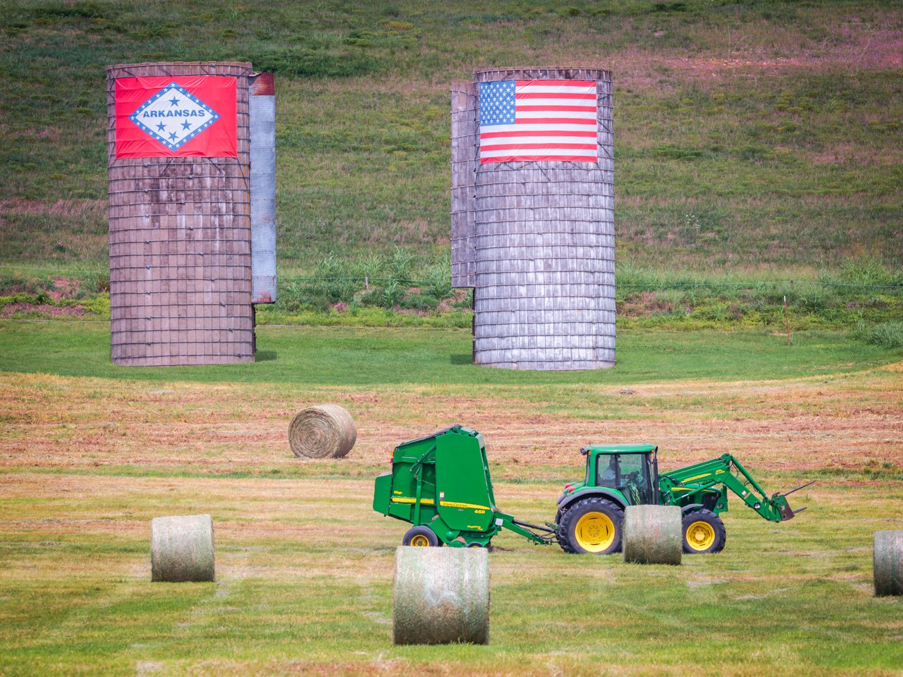 A tractor is bailing hay on a farm near Fayetteville.