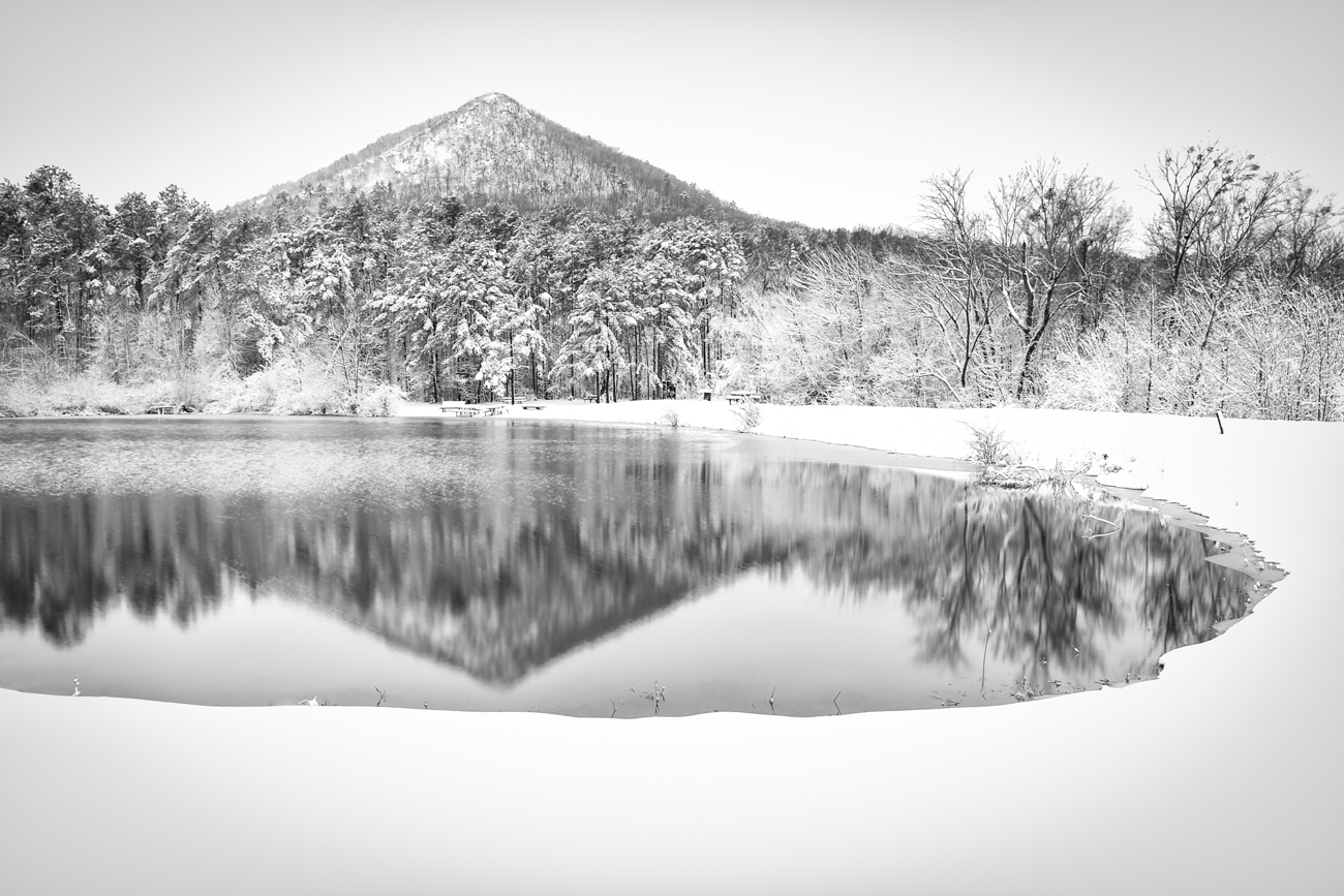 A heavy snow blankets the landscape of Pinnacle Mountain State Park west of Little Rock.