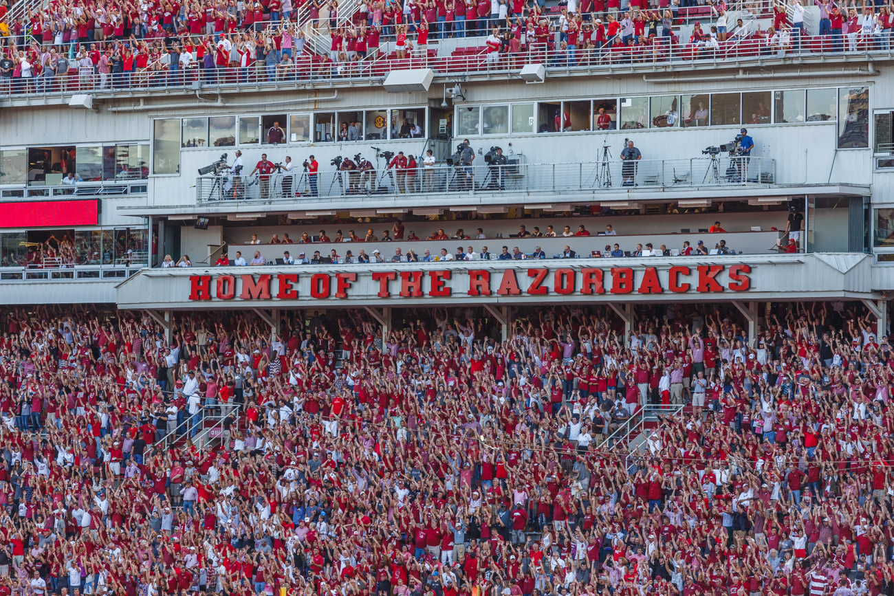 "Fans are ""Calling The Hogs"" at Razorback Stadium."